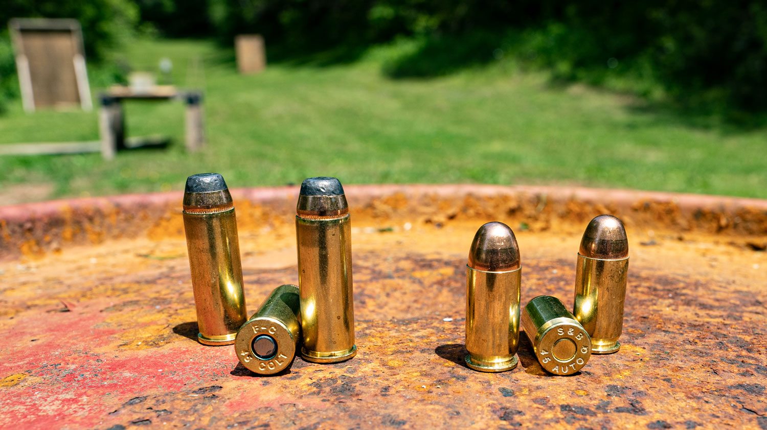 45 LC and 45 ACP ammo side by side