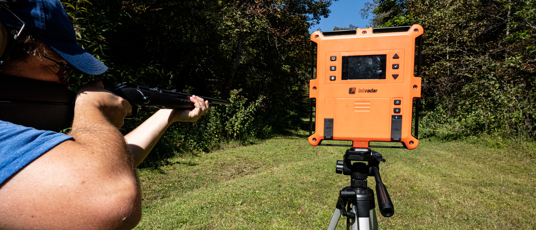 Shooting a 22 WMR rifle at the range and testing velocity with a chronograph