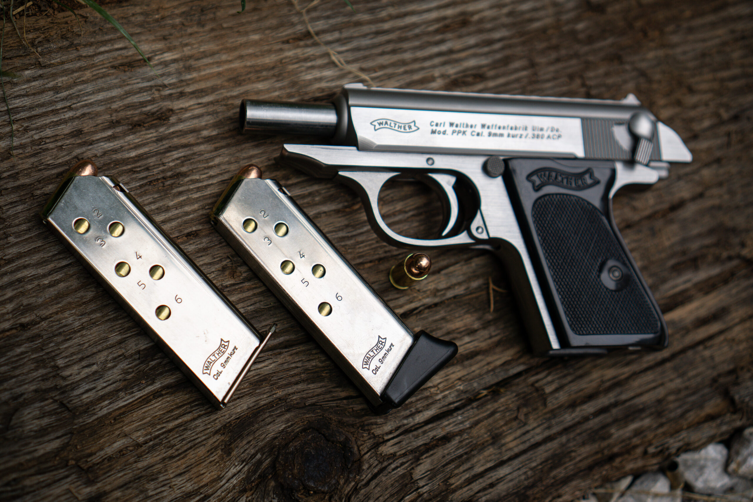 Walther PPK pistol reviewed with two magazines at a shooting bench