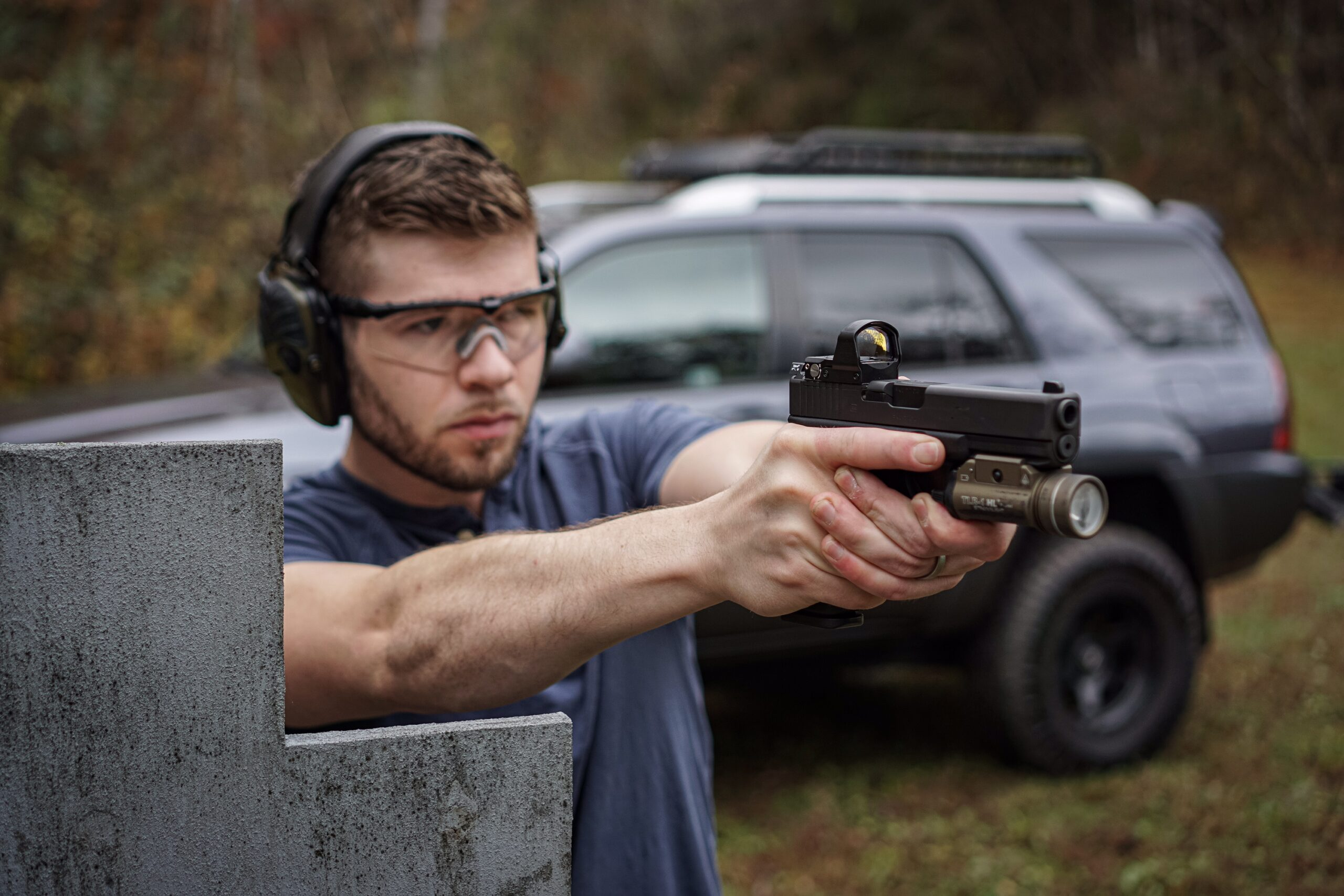 The author shooting a Gen 4 Glock 17 at a shooting range
