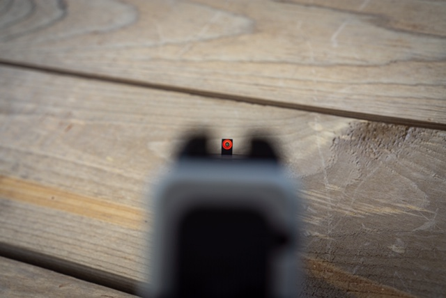 Ameriglow Night Sights shown at the shooting range