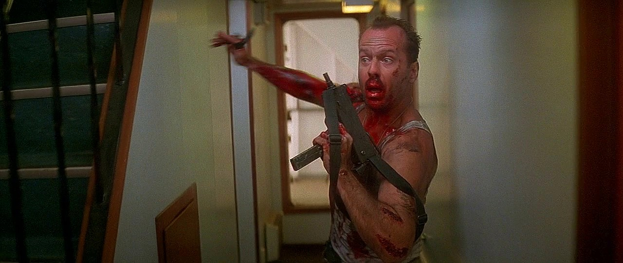 Bruce Willis in Die Hard With a Vengeance carrying a Mac-10