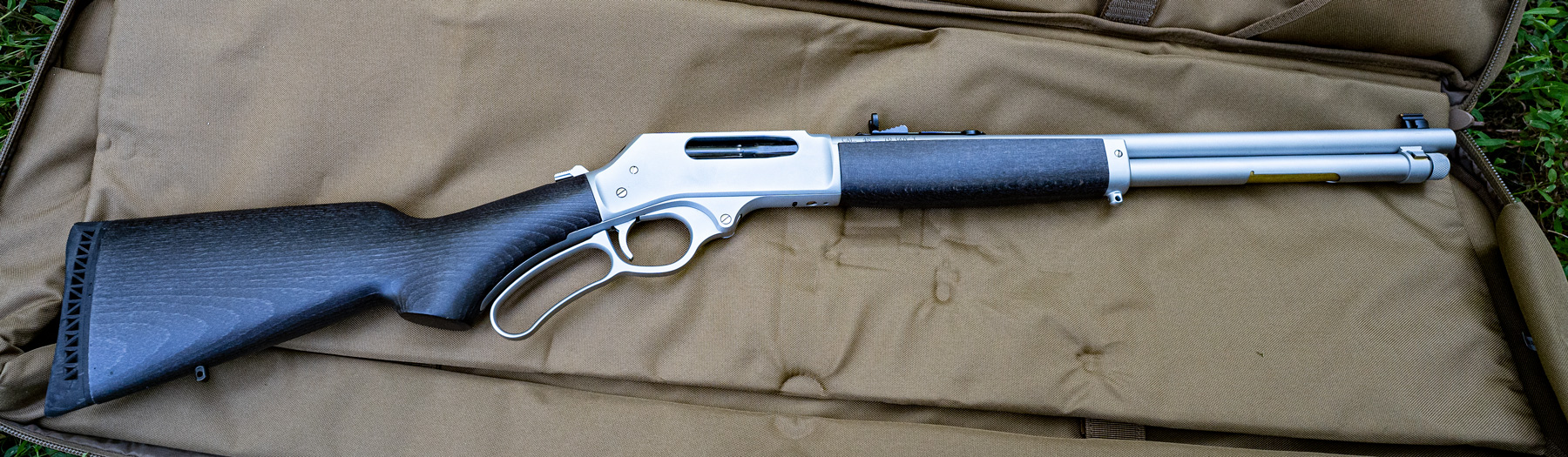 A lever action long gun made by Henry
