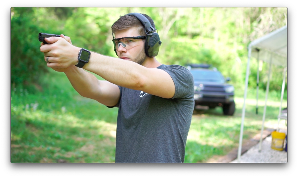 Nolan, the author testing the Ruger pistol at the range