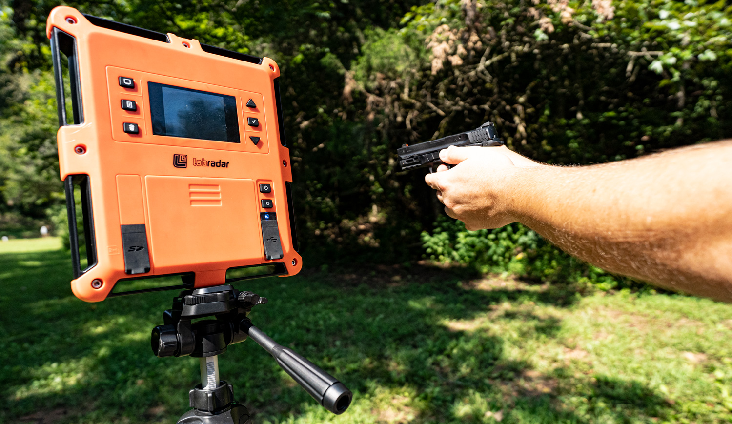 Measure a bullet's velocity with a chronograph at a shooting range.