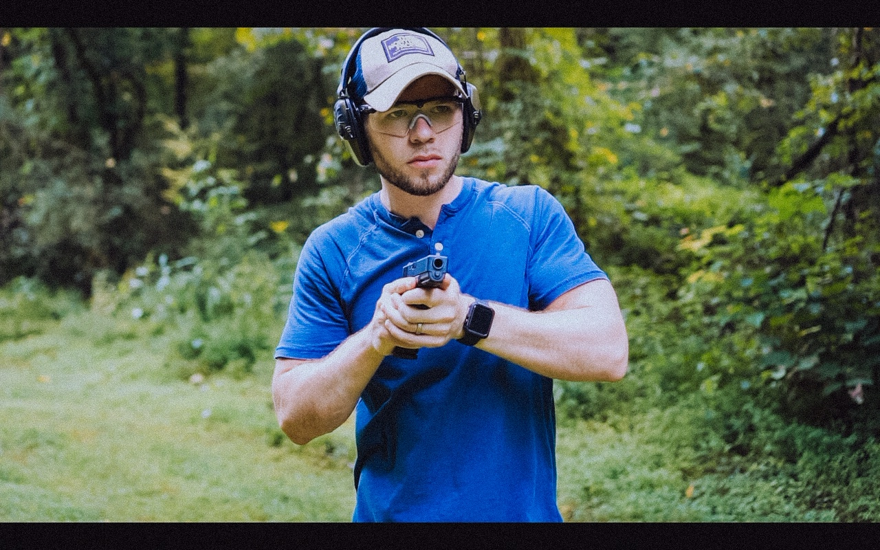 Author firing the Glock 21 at the range as part of his review.