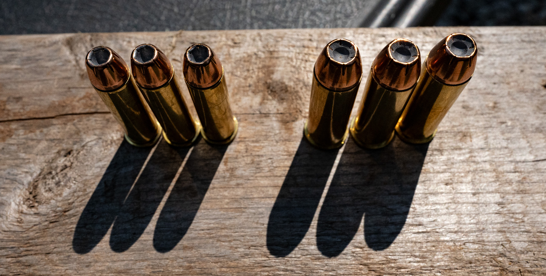 357 magnum vs 44 magnum ammo lined up on a table