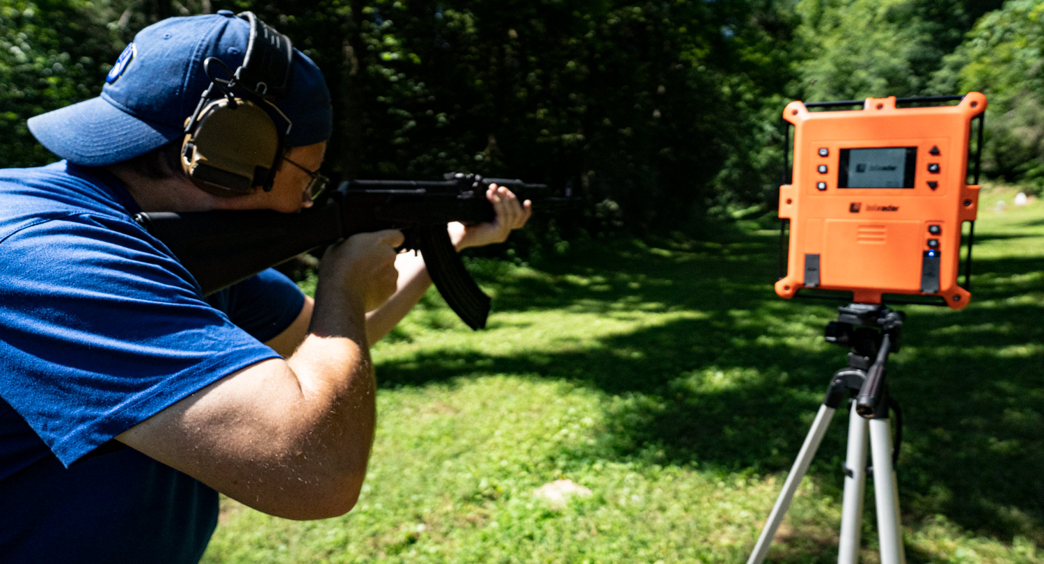 The author shooting an AK-47 at a shooting range