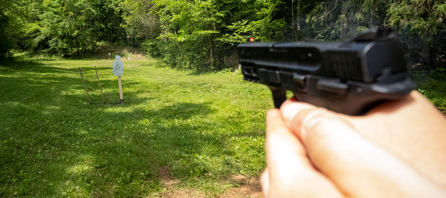 Firing a handgun at the shooting range