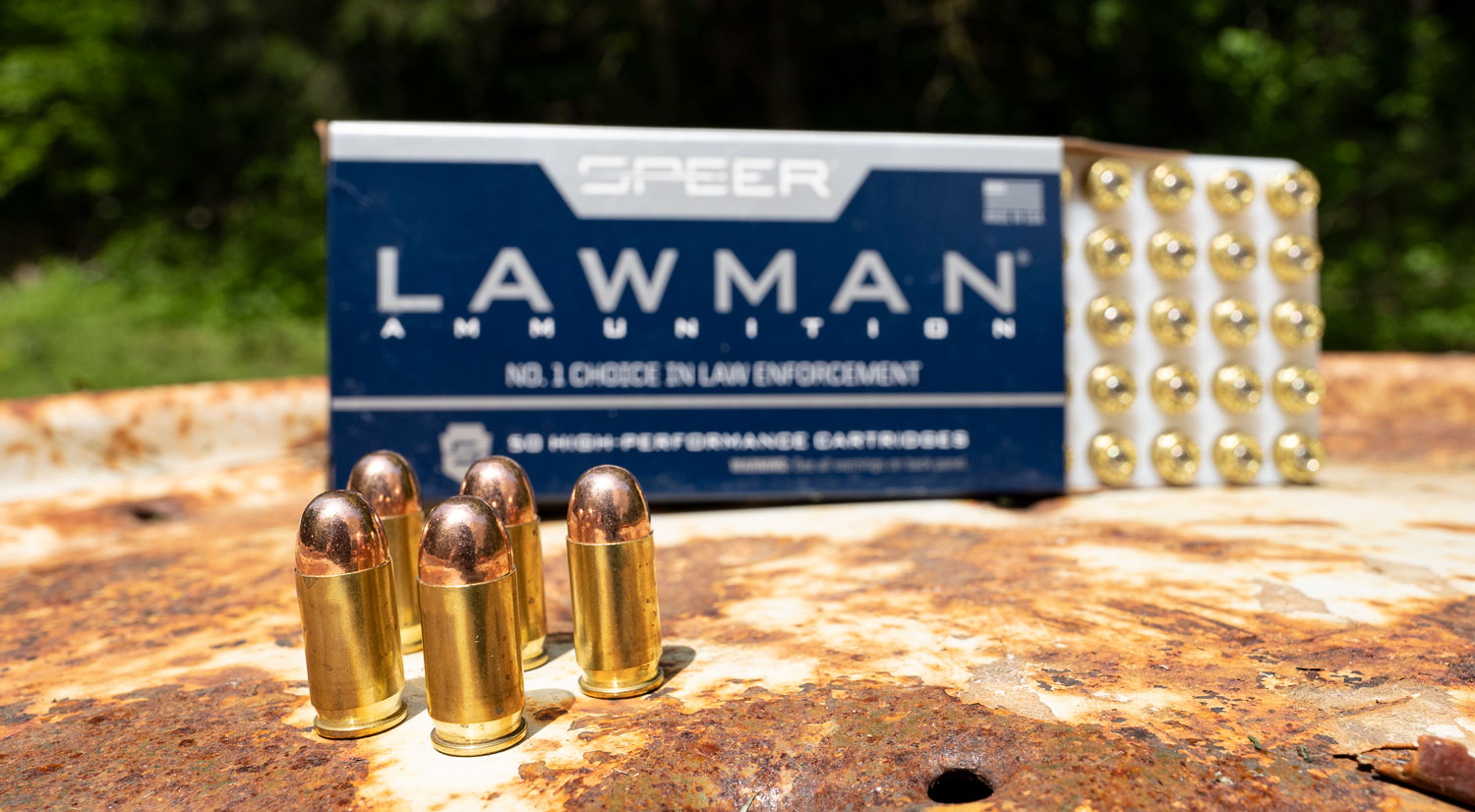 Speer lawman ammunition on a table at the shooting range